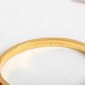 kate spade Jewelry - Kate Spade set in stone hinged bangle (Gold/Red)